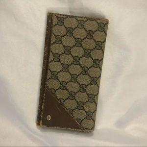 Worn vintage Gucci wallet monogram